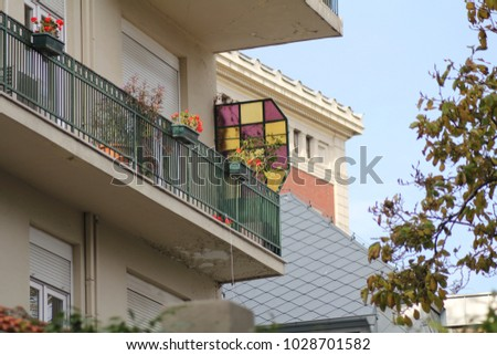 Random Turkish balcony with flowers and stained-glass. #1028701582