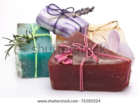 Range of different soaps on a white background.