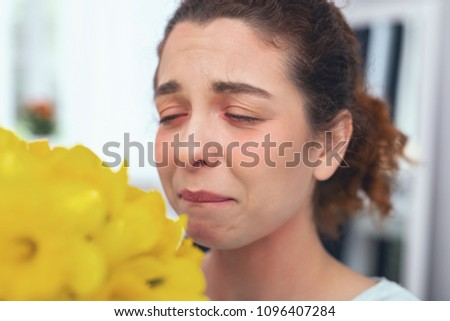 Range of mishaps. Young sad looking lady having her eyes closed biting her lip being on the edge of crying while experiencing sickness and hardships in her life #1096407284