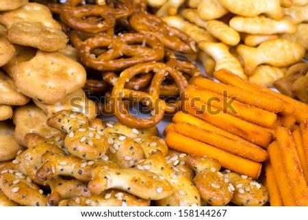 range of salty snacks lying on a white plate