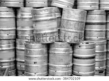 Range of stacked beer casks of kegs in black and white