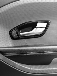 Range Rover Evoque. Car door. The interior of the car. Doorhandle.