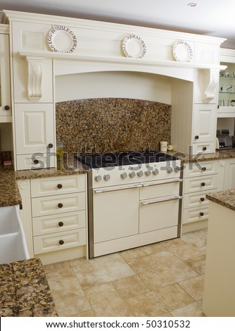 Range Style Cooker In A Modern Kitchen Interior With Granite