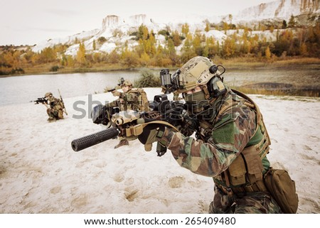 Rangers aiming at a target of weapons