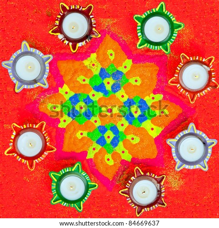 Rangoli or Colorful Floral Patterned Design Surrounded by Lamps for the Hindu Diwali Festival