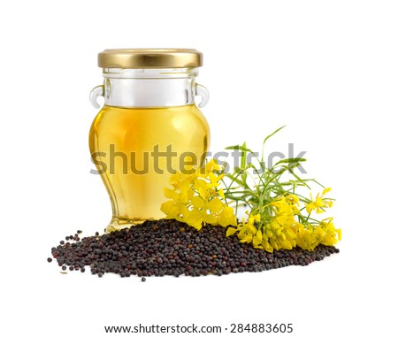 Rapeseed oil with seeds and flowers. Isolated. #284883605