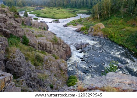 rapids on the river rapidly running among the woods and stones, forest river landscape
