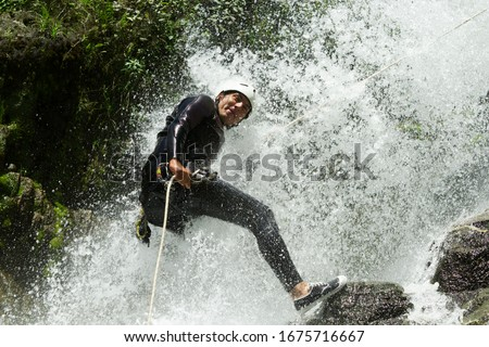 rappeling waterfall wet guide extreme canyoning guide trying out a new course in chama waterfall banos de agua santa ecuador rappeling waterfall wet guide extreme race courage canyon rappel emotion wa Photo stock ©