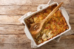 RappiePie is a French Canadian dish made of potatoes and meat close-up in a baking dish on the table. horizontal top view from above