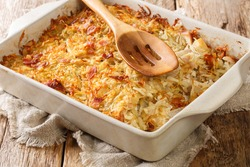 RappiePie is a French Canadian dish made of potatoes and meat close-up in a baking dish on the table. horizontal