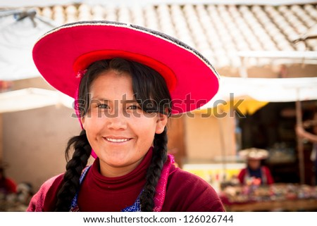 RAQCHI PERU -JANUARY 15: Quechua woman sells handcrafts at a market in Raqchi, Peru on January 15, 2013. Raqchi Ruins is a popular destination for tourism from all around the world.