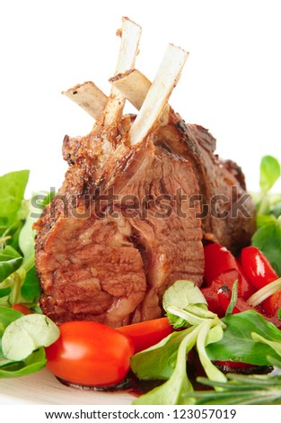 Rare fried rack of lamb isolated on white, close-up