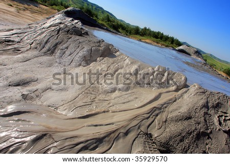 rare geological phenomenon, romanian muddy volcanoes, muddy landscape, discover Romania, eastern Europe muddy volcanoes, dry ground, footprints in the mud