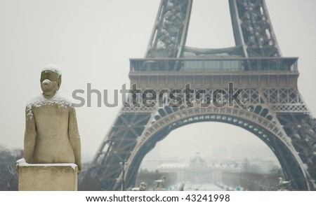 Rare snowy day in Paris. Statue of woman at the Trocadero, the Eiffel Tower and lots of snow