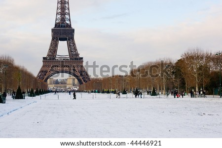Rare snowy day in Paris. The Eiffel Tower and Champ de Mars covered with snow