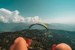 Rare View From Paragliding. Man Legs Hanging During Paraglide Flight in Pokhara, Nepal. Scenic Paragliding