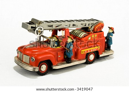 rare vintage fire truck toy isolated on white