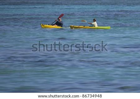 RAROTONGA, COOK ISLANDS - FEBRUARY 05: People sea kayaking in tropical lagoon of Rarotonga, Cook Islands on February 05, 2009. They train for the Cook Islands Cup in summer.
