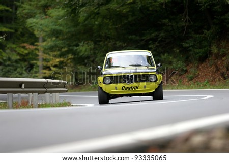 RASNOV,ROMANIA- OCT 1: Tontsch Eduard drives a BMW 2002 car during Rally of Romania 2010 championship on October 1, 2010 in RASNOV, ROMANIA