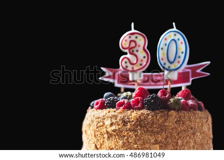 Raspberries Blackberry Birthday Cake With Candles Number 30 On Black Background And Copyspace For Your Text