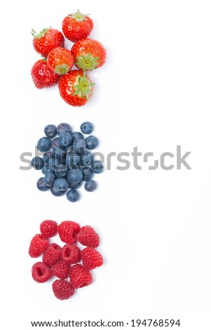 raspberries, blueberries and strawberries, top view, isolated on white