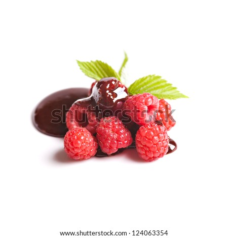 Raspberries fruits with chocolate isolated over white
