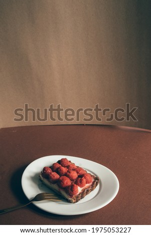 Raspberries rectangular shaped tart on a moody composition, with dark background, Photo stock ©
