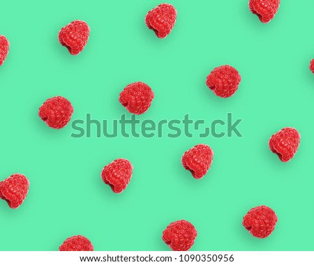 Raspberry berries pattern on vivid green, conceptual image, top view. Summer berry minimalistic flat lay background, bright colors. #1090350956