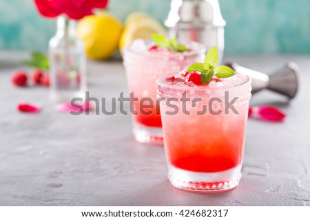 Raspberry crushed ice cold refreshing cocktail with mint