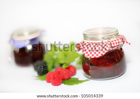 raspberry jam and blackberry jam, red and black