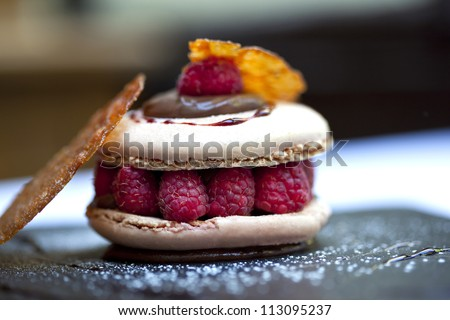 Raspberry Macaroon, tile caramel and chocolate sauce
