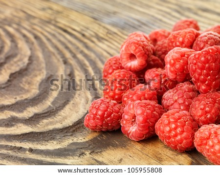 Raspberry on wood background selective focus. Fresh organic food.