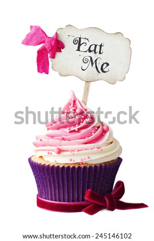 Raspberry ripple cupcake with Eat Me pick