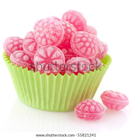 Raspberry tasty candy sweets in green cup cake paper