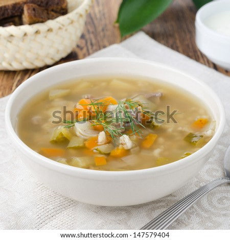 rassolnik soup in a bowl on the table close-up
