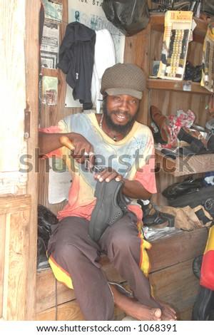 rasta man repairing shoes