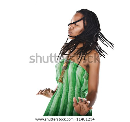 Rasta woman dancing reggae with closed eyes feeling the music