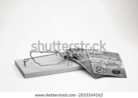 Rat trap on white background, about to grab bank notes, conceptual use for business, risk, loans, financial trouble, with copy space. Foto stock ©