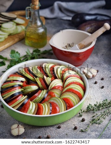Ratatouille is a traditional French Provencal vegetable dish cooked in the oven. Diet vegetarian vegetarian food - ratatouille casserole.