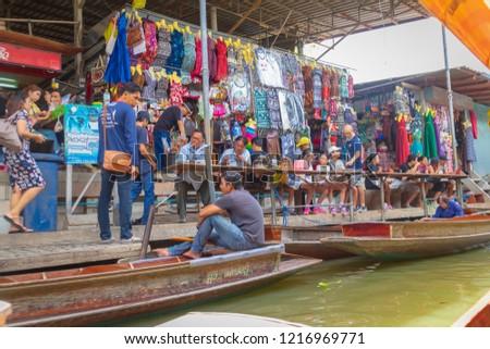 Ratchaburi, Thailand - August 14th, 2017. People are eating street food on dock at Damnoen Saduak floating market. #1216969771
