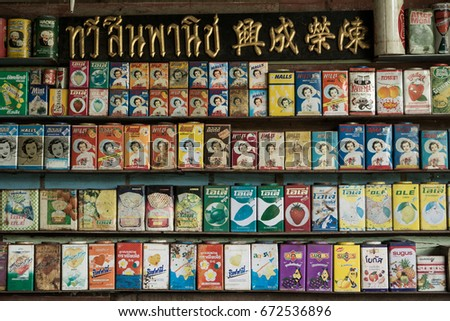 """Ratchaburi, Thailand, 24JUNE2017 : At the front of """"BANHOMTIAN"""" candle shop.Decorated with an old brand logos that have been imported to sale in Thailand #672536896"""