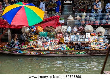 RATCHABURI, THAILAND-MARCH 20: Damnoen Saduak Floating Market on March 20,2016 in Thailand. Having many small boats laden with Souvenir shop, colourful fruits, vegetables and Thai cuisine. #462523366