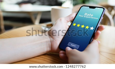 Rate your experience customer satisfaction review Five Stars on mobile phone screen. Business technology concept. #1248277762