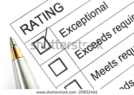 "Rating ticked in the ""exceptional"" box.  With silver and gold ballpoint pen."