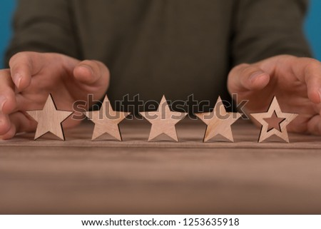 rating with star in hand #1253635918