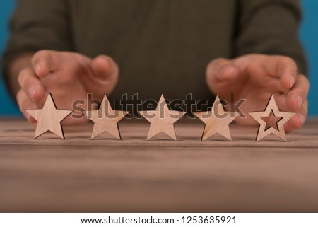 rating with star in hand #1253635921
