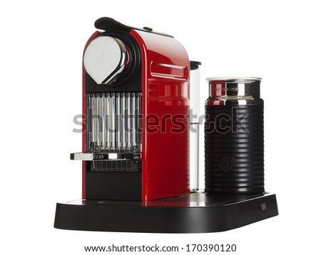 Ratingen, Germany - February 10, 2011: Fire red Nespresso Citiz coffee machine made by Krups isolated on white background.