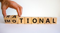 Rational or emotional symbol. Psychologist turns wooden cubes and changed the word 'rational' to 'emotional'. Beautiful white background. Psychological and rational or emotional concept. Copy space.