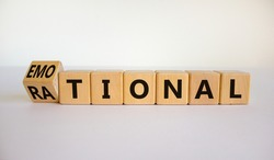 Rational or emotional symbol. Turned wooden cubes and changed the word 'rational' to 'emotional'. Beautiful white background. Psychological and rational or emotional concept. Copy space.
