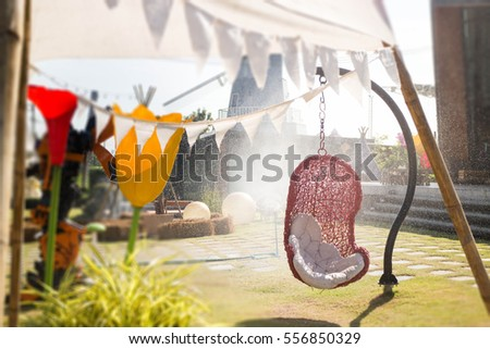 Rattan outdoor garden cradle chair, stock photo #556850329